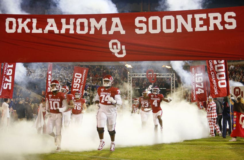 NORMAN, OK - NOVEMBER 23: Safety Pat Fields #10, and offensive lineman Marcus Alexander #74 of the Oklahoma Sooners run onto the field for a game against the TCU Horned Frogs on November 23, 2019 at Gaylord Family Oklahoma Memorial Stadium in Norman, Oklahoma. OU held on to win 28-24. (Photo by Brian Bahr/Getty Images)
