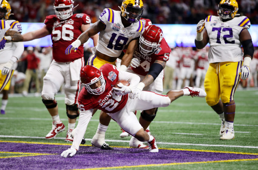 ATLANTA, GEORGIA - DECEMBER 28: Running back Kennedy Brooks #26 of the Oklahoma Sooners rushes for a touchdown in the first quarter over the LSU Tigers during the Chick-fil-A Peach Bowl at Mercedes-Benz Stadium on December 28, 2019 in Atlanta, Georgia. (Photo by Gregory Shamus/Getty Images)