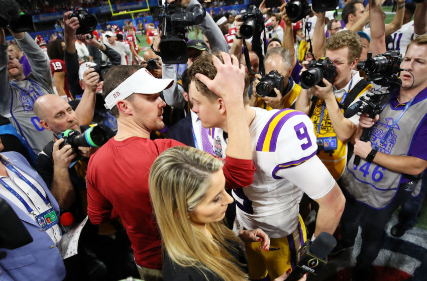 ATLANTA, GEORGIA - DECEMBER 28: Head coach Lincoln Riley of the Oklahoma Sooners and quarterback Joe Burrow #9 of the LSU Tigers embrace after LSU Tigers wins the Chick-fil-A Peach Bowl 28-63 at Mercedes-Benz Stadium on December 28, 2019 in Atlanta, Georgia. (Photo by Gregory Shamus/Getty Images)