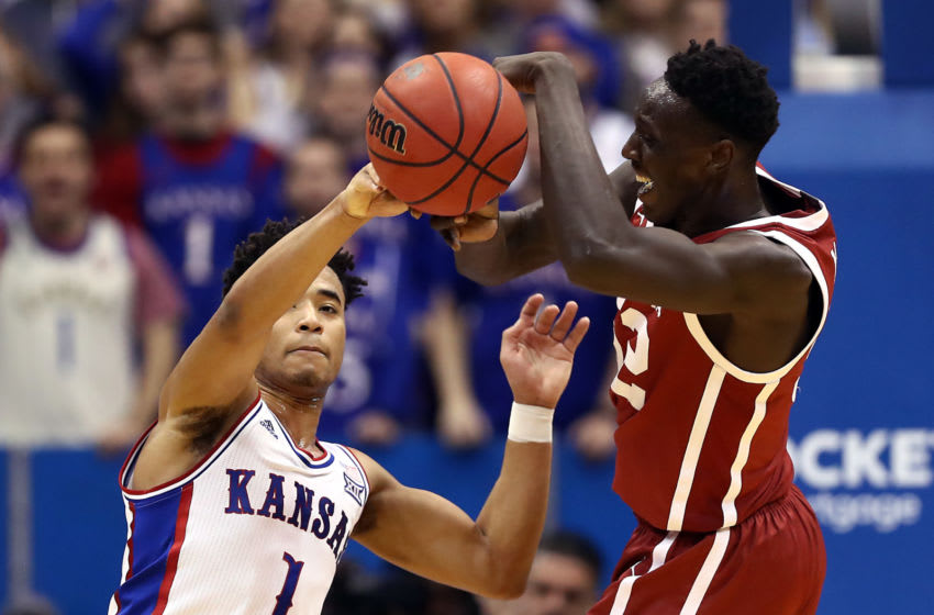 LAWRENCE, KANSAS - FEBRUARY 15: Devon Dotson #1 of the Kansas Jayhawks battles Kur Kuath #52 of the Oklahoma Sooners for a rebound during the game at Allen Fieldhouse on February 15, 2020 in Lawrence, Kansas. (Photo by Jamie Squire/Getty Images)