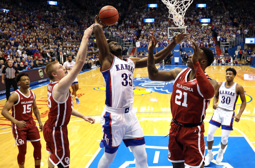 LAWRENCE, KANSAS - FEBRUARY 15: Udoka Azubuike #35 of the Kansas Jayhawks is fouled by Brady Manek #35 of the Oklahoma Sooners during the game at Allen Fieldhouse on February 15, 2020 in Lawrence, Kansas. (Photo by Jamie Squire/Getty Images)