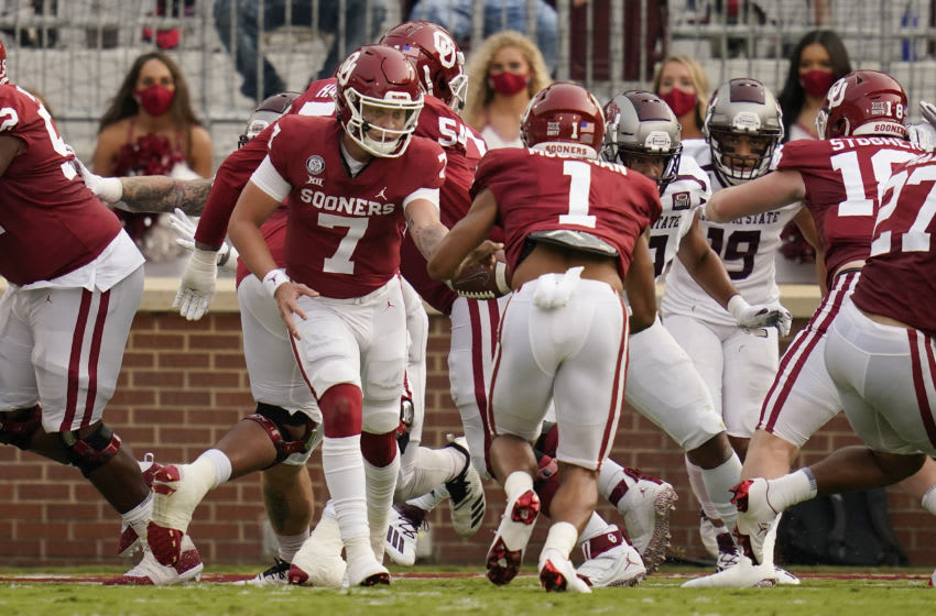 NORMAN, OK - SEPTEMBER 12: Oklahoma quarterback Spencer Rattler #7 hands off to Seth McGowan #1 who takes the ball in for a touchdown in an NCAA college football game against Missouri State on September 12, 2020, in Norman, Oklahoma. (Photo by Sue Ogrocki-Pool/Getty Images)