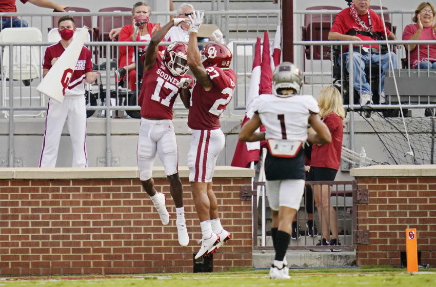 NORMAN, OK - SEPTEMBER 12: Oklahoma wide receiver Marvin Mims #17 celebrates his touchdown with teammate Jeremiah Hall #27 in front of Missouri State cornerback Zack Sanders #1 in the first half of an NCAA college football game on September 12, 2020, in Norman, Oklahoma. (Photo by Sue Ogrocki-Pool/Getty Images)
