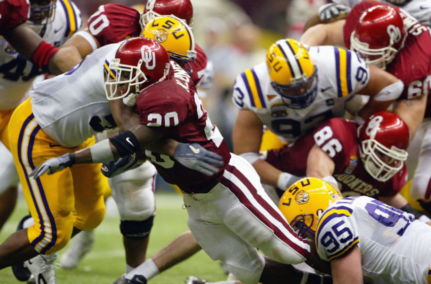 NEW ORLEANS - JANUARY 4: Running back Kejuan Jones #20 of the Oklahoma Sooners is tackled during the game against the Louisiana State Tigers in the Nokia Sugar Bowl National Championship on January 4, 2004 at the Louisiana Superdome in New Orleans, Louisiana. The LSU Tigers defeated the Oklahoma Sooners 21-14 to win the National Championship. (Photo by Andy Lyons/Getty Images)