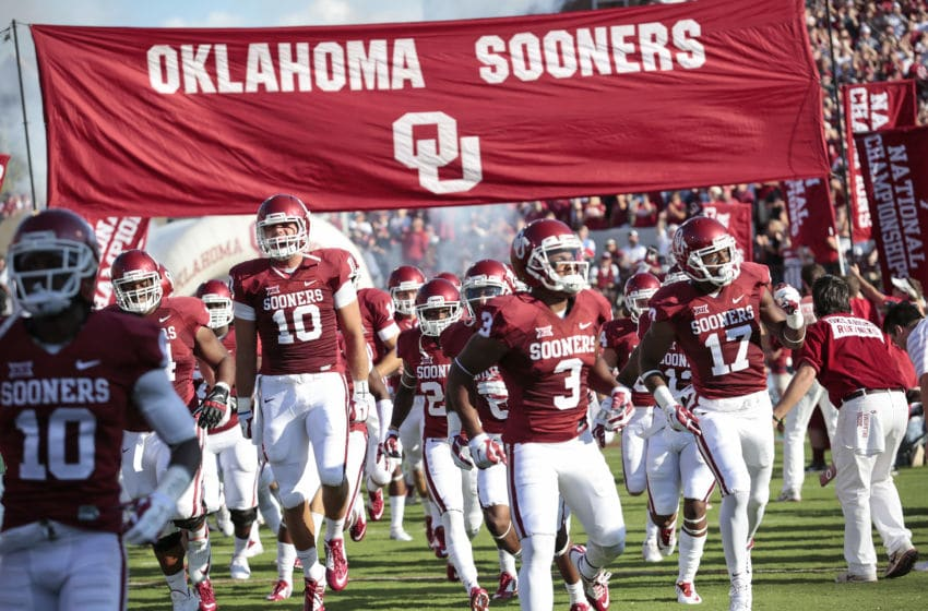 NORMAN, OK - AUGUST 30: The Oklahoma Sooners take the field before the game against the Louisiana Tech Bulldogs August 30, 2014 at Gaylord Family-Oklahoma Memorial Stadium in Norman, Oklahoma. The Sooners defeated the Bulldogs 48-16. (Photo by Brett Deering/Getty Images)