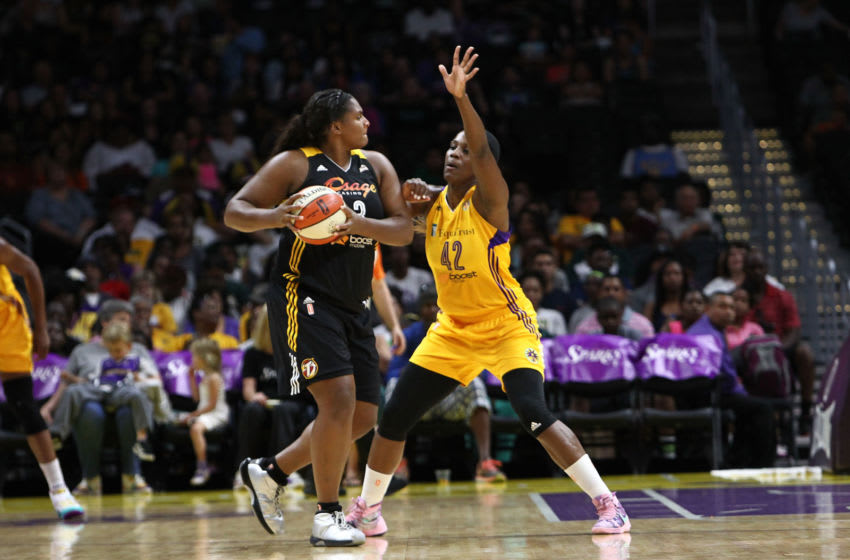 LOS ANGELES, CA - SEPTEMBER 06: Courtney Paris #3 of the Tulsa Shock handles the ball against Jantel Lavender #42 of the Los Angeles Sparks in a WNBA game at Staples Center on September 6, 2015 in Los Angeles, California. (Photo by Leon Bennett/Getty Images)