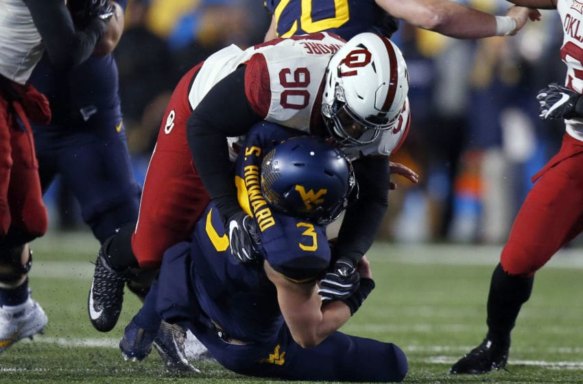 MORGANTOWN, WV - NOVEMBER 19: Neville Gallimore #90 of the Oklahoma Sooners sacks Skyler Howard #3 of the West Virginia Mountaineers in the second half on November 19, 2016 at Mountaineer Field in Morgantown, West Virginia. (Photo by Justin K. Aller/Getty Images)