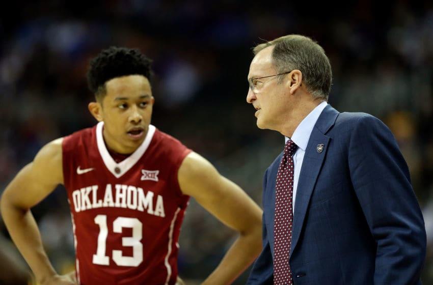 KANSAS CITY, MO - MARCH 08: Head coach Lon Kruger of the Oklahoma Sooners talks with Jordan Shepherd