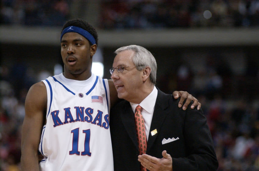 24 Mar 2002: Head coach Roy Williams of Kansas talks with Aaron Miles #11 in the second half against Oregon during the NCAA Mens Basketball Tournament at the Kohl Center in Madison, Wisconsin. The Kansas Jayhawks beat the Oregon Ducks 104-86 to advance to the Final Four in Atlanta, Georgia. DIGITAL IMAGE. Mandatory Credit: Elsa/ Getty Images.