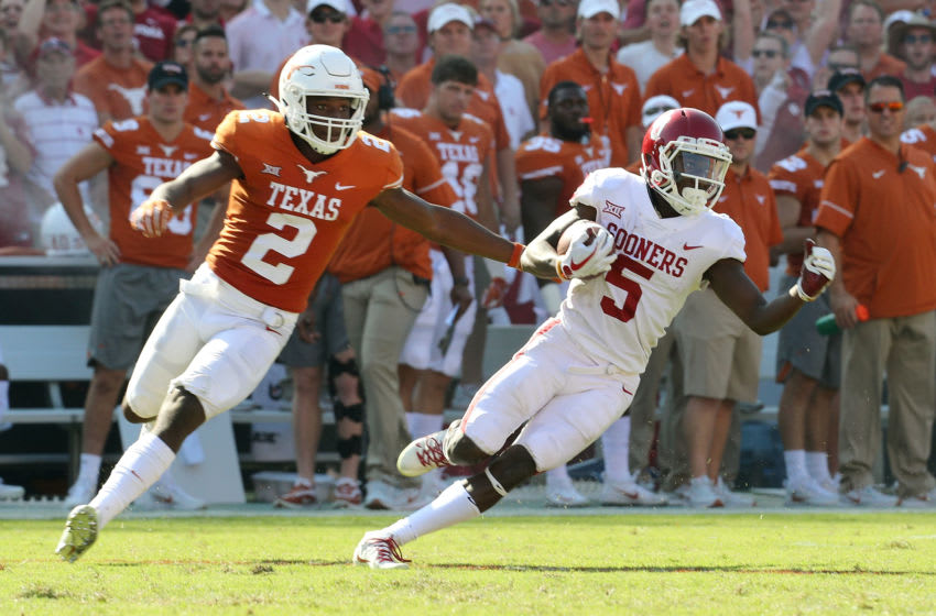 DALLAS, TX - OCTOBER 14: Kris Boyd #2 of the Texas Longhorns pursues Marquise Brown #5 of the Oklahoma Sooners in the second half of a football game at the Cotton Bowl on October 14, 2017 in Dallas, Texas. (Photo by Richard W. Rodriguez/Getty Images)
