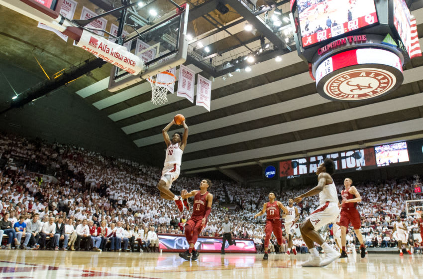 TUSCALOOSA, AL - JANUARY 27: Herbert Jones #10 of the Alabama Crimson Tide dunks the ball in front of Christian James #0 of the Oklahoma Sooners during the game at Coleman Coliseum on January 27, 2018 in Tuscaloosa, Alabama. (Photo by Michael Chang/Getty Images)