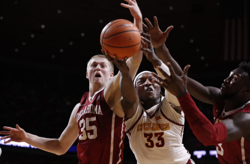 AMES, IA - FEBRUARY 10: Solomon Young #33 of the Iowa State Cyclones battles for a rebound with Brady Manek #35, and Khadeem Lattin #3 of the Oklahoma Sooners in the second half of play at Hilton Coliseum on February 10, 2018 in Ames, Iowa. The Iowa State Cyclones won 88-80 over the Oklahoma Sooners. (Photo by David Purdy/Getty Images)