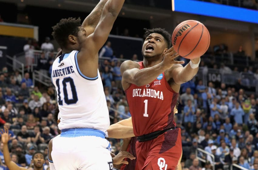 PITTSBURGH, PA - MARCH 15: Rashard Odomes #1 of the Oklahoma Sooners tries to get a shot past Cyril Langevine #10 of the Rhode Island Rams during the first round of the 2018 NCAA Men's Basketball Tournament at PPG PAINTS Arena on March 15, 2018 in Pittsburgh, Pennsylvania. (Photo by Rob Carr/Getty Images)