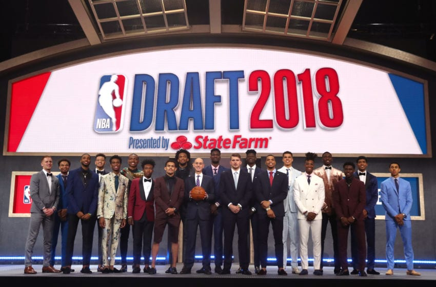NEW YORK, NY - JUNE 21: NBA Commissioner Adam Silver poses with (L-R) Donte DiVincenzo, Jerome Robinson, Mikal Bridges, Kevin Knox, Shai Gilgeous-Alexander, Wendell Carter Jr., Collin Sexton, Marvin Bagley III, Trae Young, Deandre Ayton, Luka Doncic, Miles Bridges, Michael Porter Jr., Lonnie Walker IV, Jaren Jackson, Aaron Holiday, Chandler Hutchison and Zhaire Smith pose for a photo before the 2018 NBA Draft at the Barclays Center on June 21, 2018 in the Brooklyn borough of New York City. NOTE TO USER: User expressly acknowledges and agrees that, by downloading and or using this photograph, User is consenting to the terms and conditions of the Getty Images License Agreement. (Photo by Mike Stobe/Getty Images)