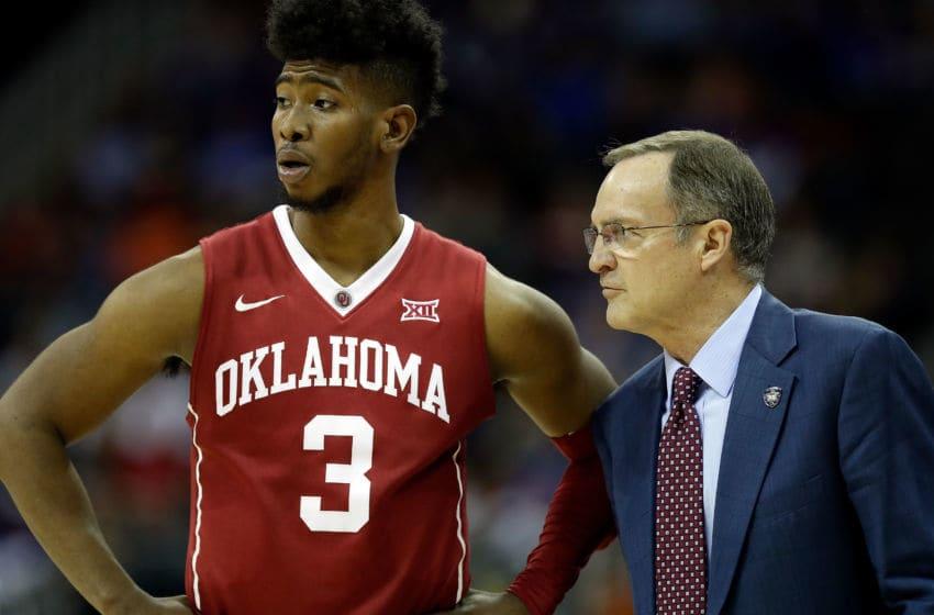 KANSAS CITY, MO - MARCH 08: Head coach Lon Kruger of the Oklahoma Sooners talks with Christian James