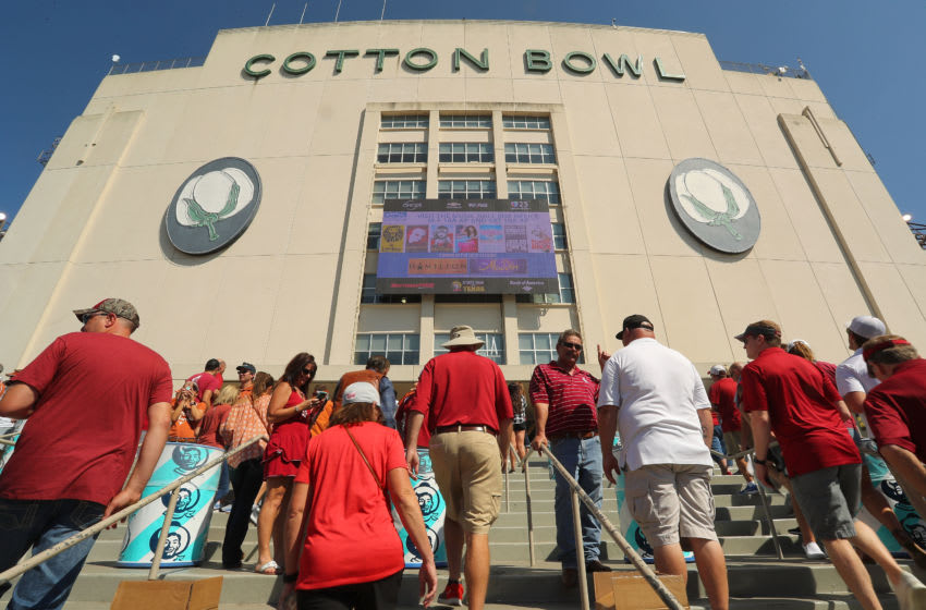 DALLAS, TX - OCTOBER 14: Fans make their way into stadium for the game football game between the Oklahoma Sooners and the Texas Longhorns at Cotton Bowl on October 14, 2017 in Dallas, Texas. (Photo by Richard W. Rodriguez/Getty Images)