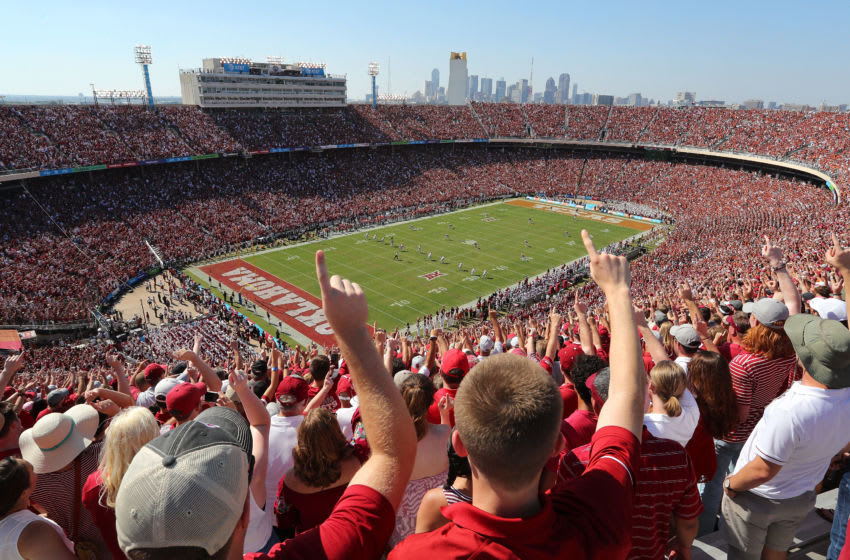 DALLAS, TX - OCTOBER 14: Fans cheer during the kickoff for the game between the Oklahoma Sooners and Texas Longhorns at Cotton Bowl on October 14, 2017 in Dallas, Texas. The Dallas skyline appears in the background. (Photo by Richard W. Rodriguez/Getty Images)
