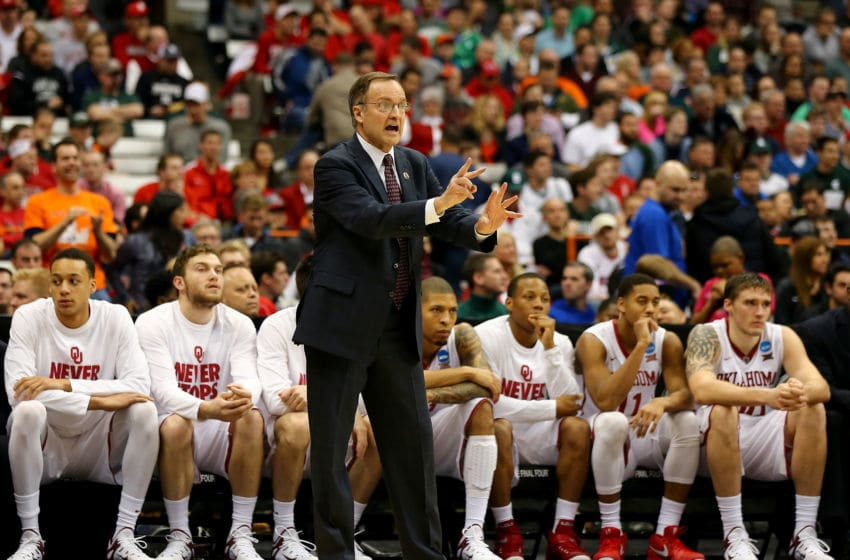 SYRACUSE, NY - MARCH 27: Head coach Lon Kruger of the Oklahoma Sooners encourages his players in the second half against the Michigan State Spartans during the East Regional Semifinal of the 2015 NCAA Men's Basketball Tournament at the Carrier Dome on March 27, 2015 in Syracuse, New York. (Photo by Elsa/Getty Images)