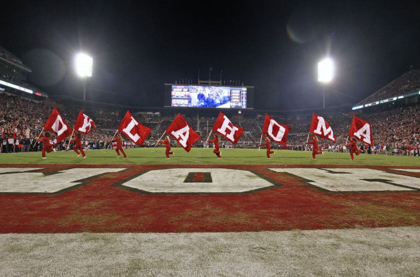 NORMAN, OK - OCTOBER 28: Members of the Oklahoma Sooners spirit squad celebrate a touchdown against the Texas Tech Red Raiders at Gaylord Family Oklahoma Memorial Stadium on October 28, 2017 in Norman, Oklahoma. Oklahoma defeated Texas Tech 49-27. (Photo by Brett Deering/Getty Images) *** Local Caption ***