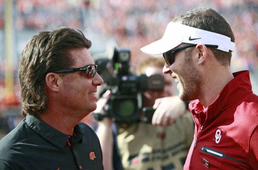 STILLWATER, OK - NOVEMBER 04: Head coach Mike Gundy of the Oklahoma State Cowboys and head coach Lincoln Riley of the Oklahoma Sooners meet on the field before the game at Boone Pickens Stadium on November 4, 2017 in Stillwater, Oklahoma. Oklahoma defeated Oklahoma State 62-52. (Photo by Brett Deering/Getty Images)