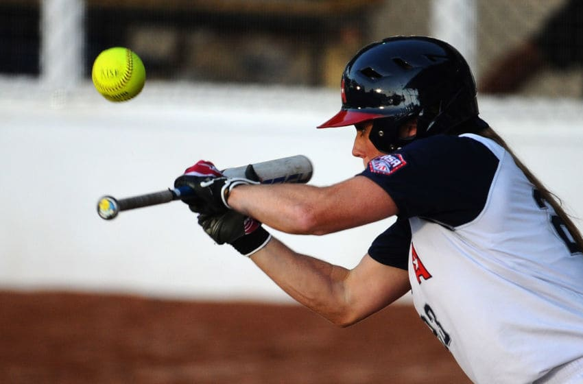 GUADALAJARA, MEXICO - OCTOBER 17: Ashley Holcombe of the United States of America hits the ball during the Softball Preliminary Round match between the United States of America and Venezuela during Day Three of the XVI Pan American Games at CODE Alcalde on October 17, 2011 in Guadalajara, Mexico. (Photo by Dennis Grombkowski/Getty Images)