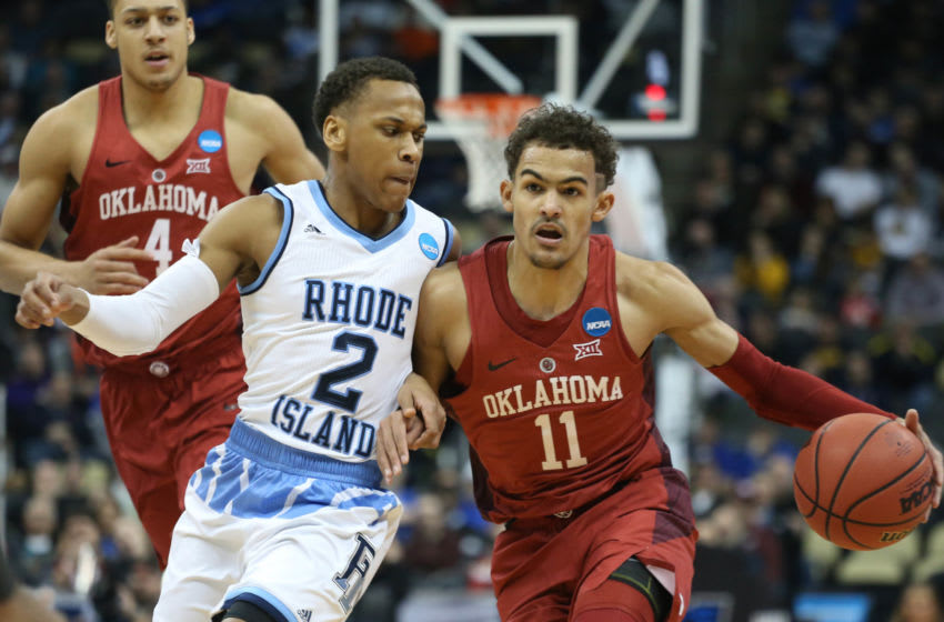 Mar 15, 2018; Pittsburgh, PA, USA; Oklahoma Sooners guard Trae Young (11) dribbles the ball against Rhode Island Rams guard Fatts Russell (2) during the first half in the first round of the 2018 NCAA Tournament at PPG Paints Arena. Rhode Island won 83-78 in overtime. Mandatory Credit: Charles LeClaire-USA TODAY Sports