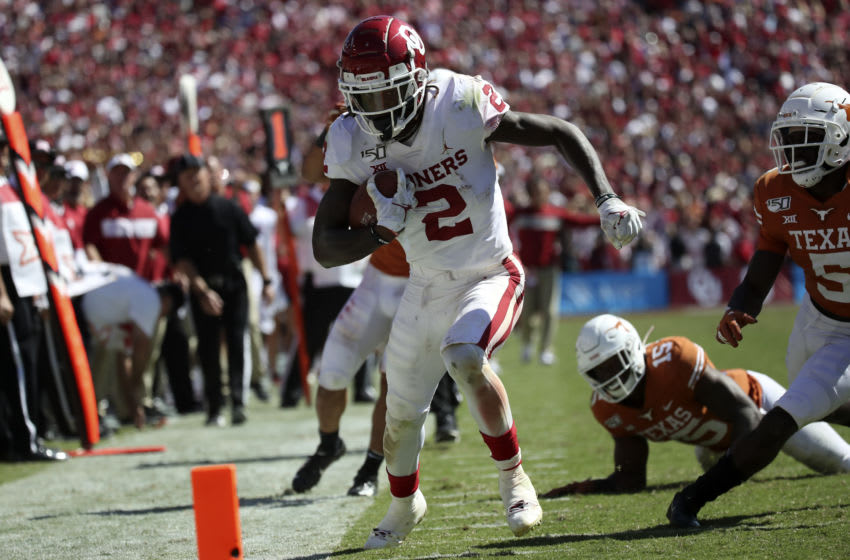 Oct 12, 2019; Dallas, TX, USA; Oklahoma Sooners wide receiver CeeDee Lamb (2) runs over Texas Longhorns defensive back Chris Brown (15) and scores a touchdown during the second half at the Cotton Bowl. Mandatory Credit: Kevin Jairaj-USA TODAY Sports