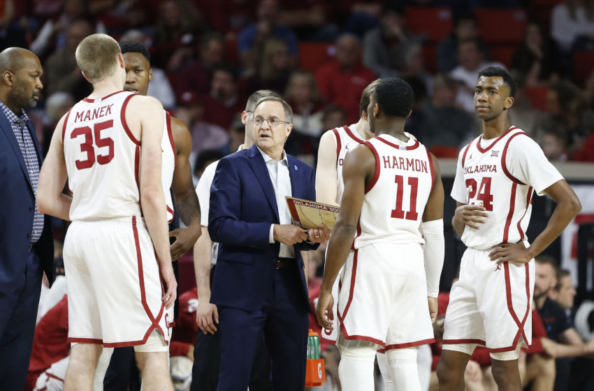 Feb 1, 2020; Norman, Oklahoma, USA; Oklahoma Sooners head coach Lon Kruger, center, talks to his team during a time out against the Oklahoma State Cowboys during the first half at Lloyd Noble Center. Mandatory Credit: Alonzo Adams-USA TODAY Sports