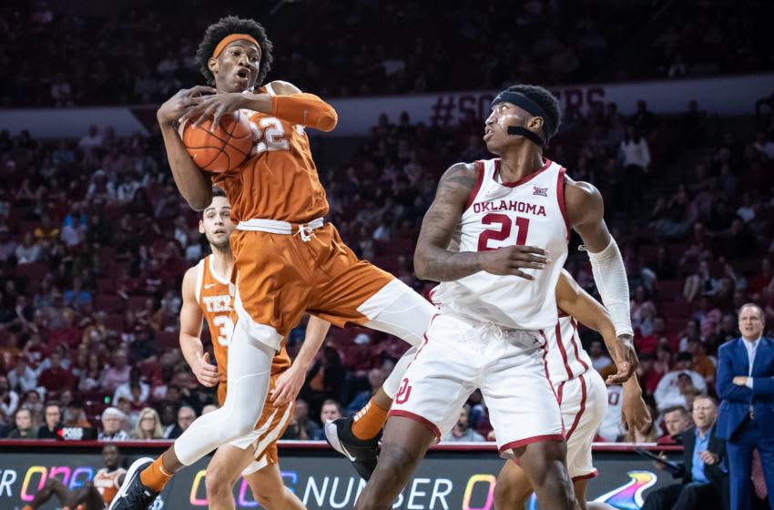 Mar 3, 2020; Norman, Oklahoma, USA; Texas Longhorns forward Kai Jones (22) rebounds while defended by Oklahoma Sooners forward Kristian Doolittle (21) during the first half at Lloyd Noble Center. Mandatory Credit: Rob Ferguson-USA TODAY Sports