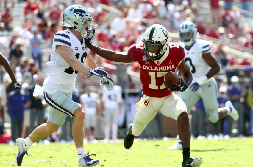 Sep 26, 2020; Norman, Oklahoma, USA; Oklahoma Sooners wide receiver Marvin Mims (17) runs with the ball as Kansas State Wildcats defensive back Ross Elder (19) defends during the first half at Gaylord Family Oklahoma Memorial Stadium. Mandatory Credit: Kevin Jairaj-USA TODAY Sports