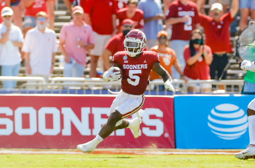 Oct 10, 2020; Dallas, Texas, USA; Oklahoma Sooners running back T.J. Pledger (5) runs wide against the Texas Longhorns during the first quarter of the Red River Showdown at Cotton Bowl. Mandatory Credit: Andrew Dieb-USA TODAY Sports