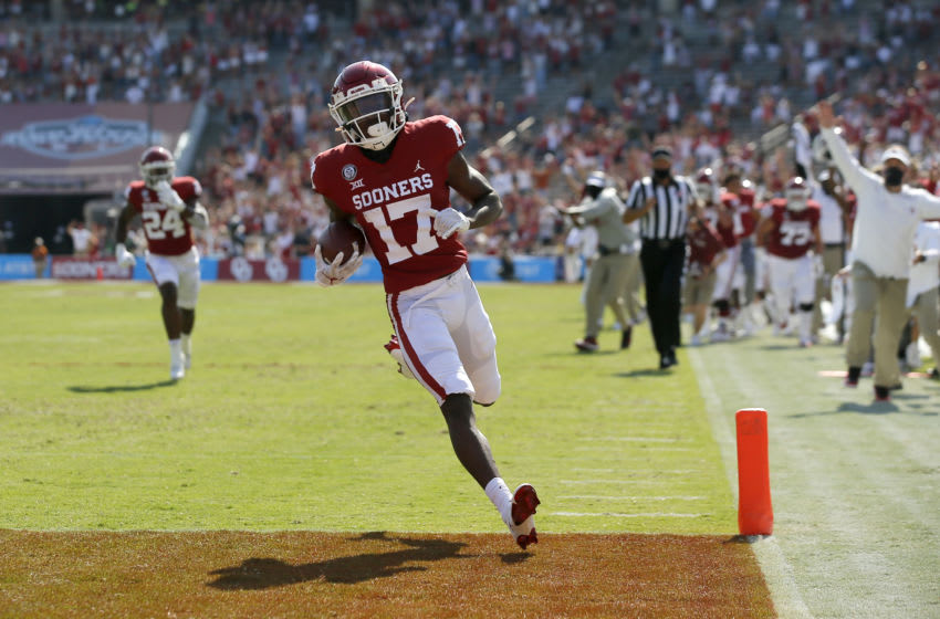 Oct 10, 2020; Dallas, Texas, USA; Oklahoma player Marvin Mims (17) scores a touchdown during the Red River Showdown college football game between the Oklahoma Sooners (OU) and the Texas Longhorns (UT) at Cotton Bowl Stadium in Dallas, Saturday, Oct. 10, 2020. Mandatory Credit: Bryan Terry-USA TODAY NETWORK