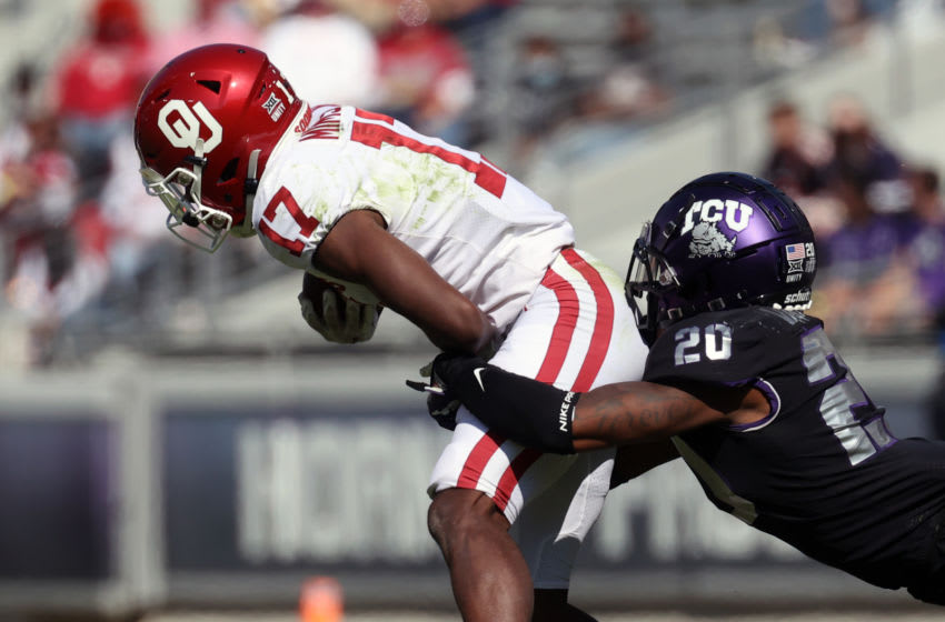 Oct 24, 2020; Fort Worth, Texas, USA; TCU Horned Frogs safety La'Kendrick Van Zandt (20) tackles Oklahoma Sooners wide receiver Marvin Mims (17) during the first half at Amon G. Carter Stadium. Mandatory Credit: Kevin Jairaj-USA TODAY Sports