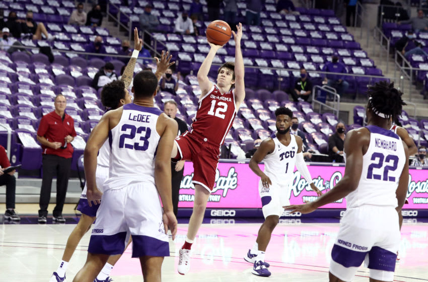 Dec 6, 2020; Fort Worth, Texas, USA; Oklahoma Sooners guard Austin Reaves (12) shoots against the TCU Horned Frogs during the second half at Ed and Rae Schollmaier Arena. Mandatory Credit: Kevin Jairaj-USA TODAY Sports