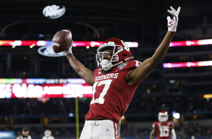 Dec 30, 2020; Arlington, TX, USA; Oklahoma Sooners wide receiver Marvin Mims (17) celebrates after scoring a touchdown against the Florida Gators in the first quarter at ATT Stadium. Mandatory Credit: Tim Heitman-USA TODAY Sports