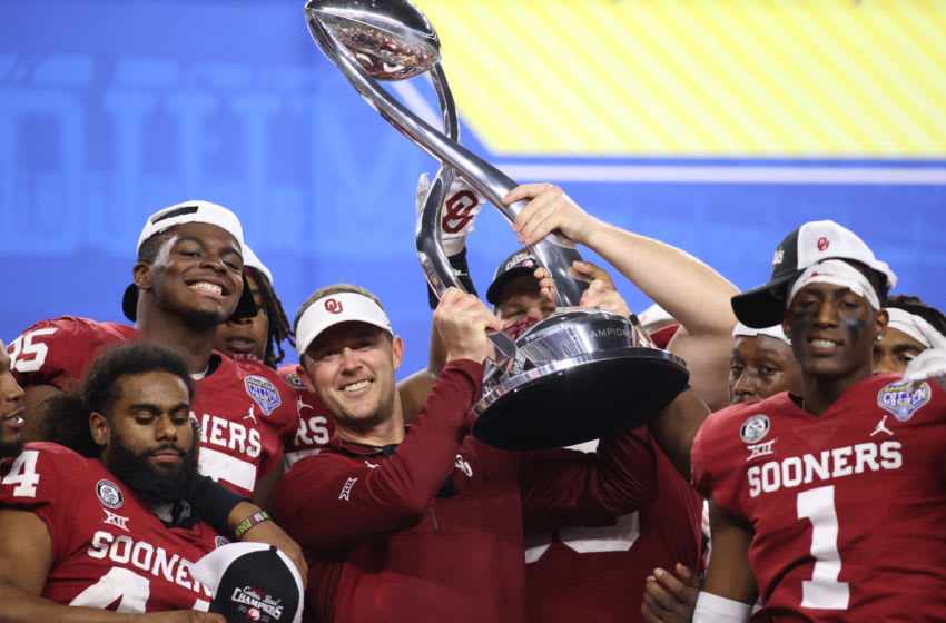 Dec 30, 2020; Arlington, TX, USA; Oklahoma Sooners head coach Lincoln Riley holds up the trophy after the game against the Florida Gators at ATT Stadium. Mandatory Credit: Tim Heitman-USA TODAY Sports