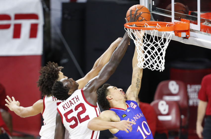 Jan 23, 2021; Norman, Oklahoma, USA; Kansas Jayhawks forward Jalen Wilson (10) goes up for a basket as Oklahoma Sooners forward Kur Kuath (52) defends the basket during the first half at Lloyd Noble Center. Mandatory Credit: Alonzo Adams-USA TODAY Sports