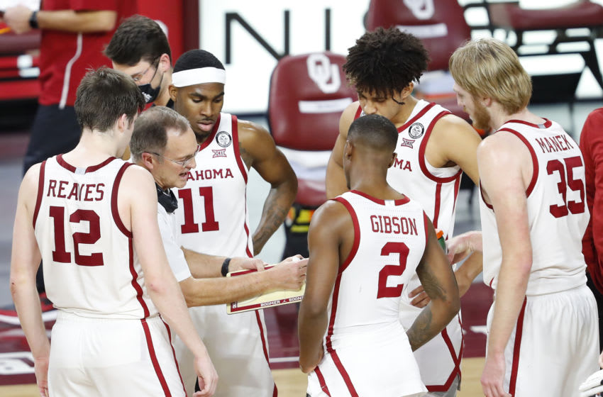 Feb 27, 2021; Norman, Oklahoma, USA; Oklahoma Sooners head coach Lon Kruger coaches his team against the Oklahoma State Cowboys during a time out in the second half at Lloyd Noble Center. Oklahoma State won 94-90. Mandatory Credit: Alonzo Adams-USA TODAY Sports