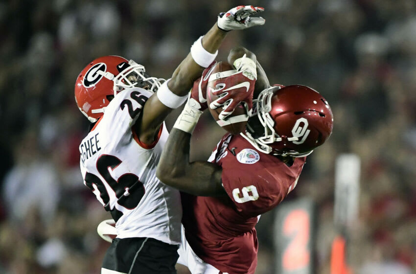 January 1, 2018; Pasadena, CA, USA; Oklahoma Sooners wide receiver CeeDee Lamb (9) catches a pass against Georgia Bulldogs defensive back Tyrique McGhee (26) during the second half in the 2018 Rose Bowl college football playoff semifinal game at Rose Bowl Stadium. Mandatory Credit: Gary A. Vasquez-USA TODAY Sports
