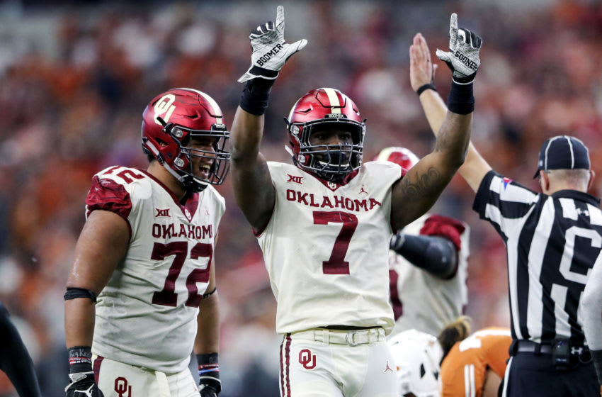 Dec 1, 2018; Arlington, TX, USA; Oklahoma Sooners defensive end Ronnie Perkins (7) and defensive end Amani Bledsoe (72) react during the game against the Texas Longhorns in the Big 12 Championship game at AT&T Stadium. Mandatory Credit: Kevin Jairaj-USA TODAY Sports