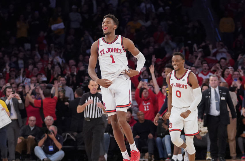 St. John's basketball forward Josh Roberts celebrates following a victory. (Photo by Porter Binks/Getty Images)
