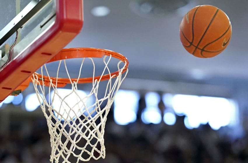 A ball goes towards the rim in a St. John's basketball game. (Photo by Steven Ryan/Getty Images)