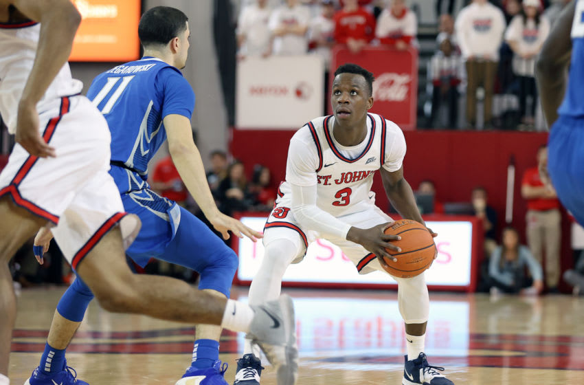 Mar 1, 2020; Queens, New York, USA; St. John's Red Storm guard Rasheem Dunn (3) controls the ball against Creighton Bluejays guard Marcus Zegarowski (11) during the second half at Carnesecca Arena. Mandatory Credit: Vincent Carchietta-USA TODAY Sports