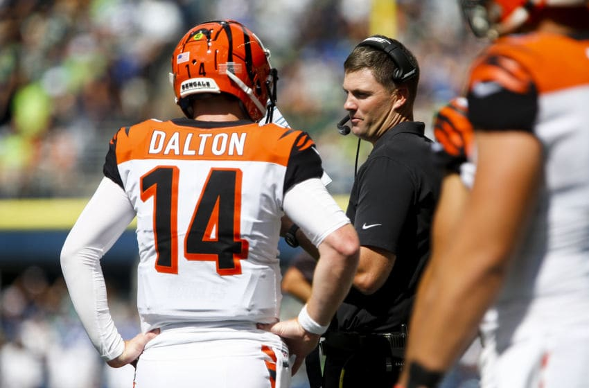 SEATTLE, WA - SEPTEMBER 08: Andy Dalton #14 of the Cincinnati Bengals talks with Bengals head coach Zac Taylor at CenturyLink Field on September 8, 2019 in Seattle, Washington. (Photo by Lindsey Wasson/Getty Images)