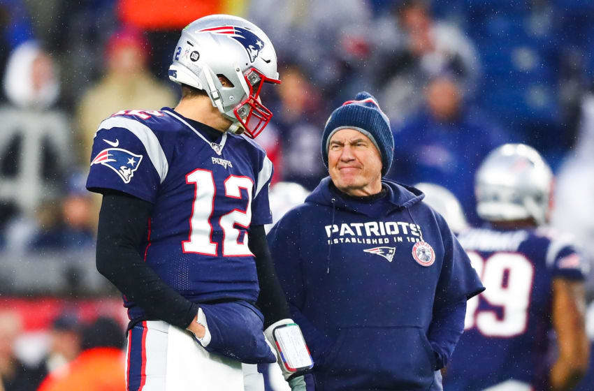 FOXBOROUGH, MA - NOVEMBER 24: Tom Brady #12 talks to head coach Bill Belichick of the New England Patriots before a game against the Dallas Cowboys at Gillette Stadium on November 24, 2019 in Foxborough, Massachusetts. (Photo by Adam Glanzman/Getty Images)