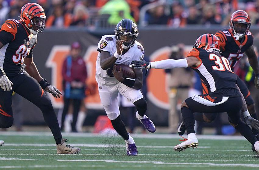 CINCINNATI, OHIO - NOVEMBER 10: Lamar Jackson #8 of the Baltimore Ravens runs with the ball during the NFL football game against the Cincinnati Bengals at Paul Brown Stadium on November 10, 2019 in Cincinnati, Ohio. (Photo by Bryan Woolston/Getty Images)