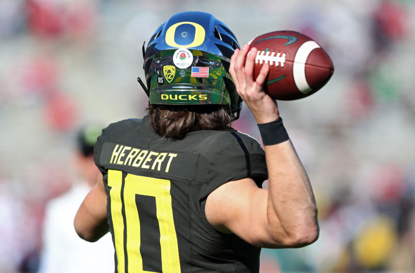 PASADENA, CALIFORNIA - JANUARY 01: Justin Herbert #10 of the Oregon Ducks warms up prior to Rose Bowl game presented by Northwestern Mutual against the Wisconsin Badgers at Rose Bowl on January 01, 2020 in Pasadena, California. (Photo by Joe Scarnici/Getty Images)