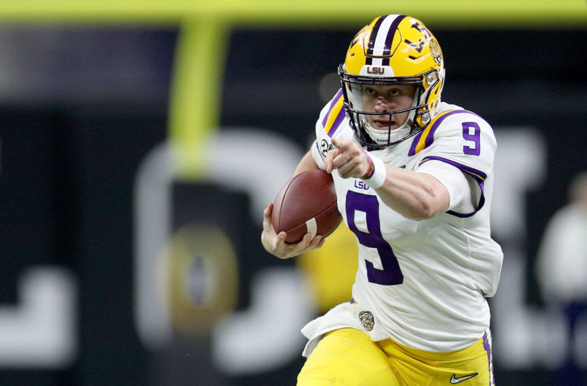 NEW ORLEANS, LOUISIANA - JANUARY 13: Joe Burrow #9 of the LSU Tigers runs the ball against the Clemson Tigers during the College Football Playoff National Championship game at Mercedes Benz Superdome on January 13, 2020 in New Orleans, Louisiana. (Photo by Chris Graythen/Getty Images)