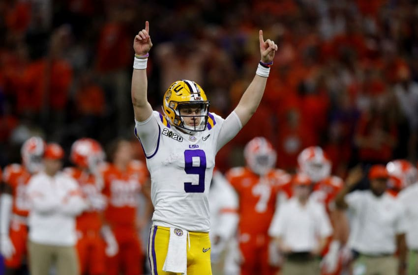 NEW ORLEANS, LOUISIANA - JANUARY 13: Joe Burrow #9 of the LSU Tigers reacts to a touchdown against Clemson Tigers during the third quarter in the College Football Playoff National Championship game at Mercedes Benz Superdome on January 13, 2020 in New Orleans, Louisiana. (Photo by Jonathan Bachman/Getty Images)
