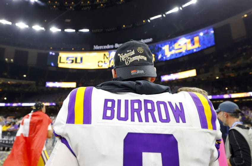 NEW ORLEANS, LOUISIANA - JANUARY 13: Joe Burrow #9 of the LSU Tigers celebrates after defeating the Clemson Tigers 42-25 in the College Football Playoff National Championship game at Mercedes Benz Superdome on January 13, 2020 in New Orleans, Louisiana. (Photo by Kevin C. Cox/Getty Images)